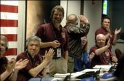 James Graf, standing, project manager of NASA's Mars Reconnaissance Orbiter project, reacts after the spacecraft successfully entered Mars orbit, at NASA's Jet Propulsion Laboratory in Pasadena, Calif., Friday, March 10, 2006.