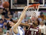North Carolina's Tyler Hansbrough, left, misses a dunk as Boston College's Sean Williams defends. The Eagles beat the Tar Heels, 85-82, Saturday in Greensboro, N.C.