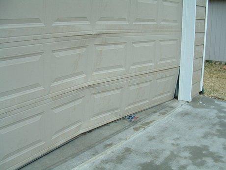 Reader photos storm damage for Wind code garage doors