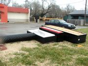 A Taco John's sign was blown down by the tornadic winds