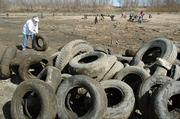 Susie Nightingale, Lawrence, joined about 80 volunteers Saturday in an effort to remove hundreds of tires from a sandbank on the Kansas River near Linwood. The Friends of the Kaw, the Kansas Department of Health and Environment and Amcor Inc. assisted in the project.