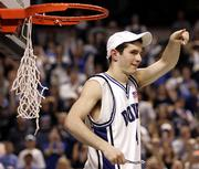 Duke's J.J. Redick signals to the crowd after he cut the net to celebrate beating Boston College for the ACC tournament title. Duke won, 78-76, Sunday in Greensboro, N.C.