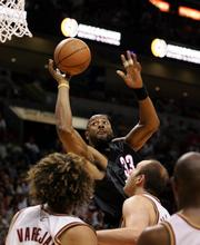 Miami center Alonzo Mourning (33) goes up for a shot. Mourning's 16 points filled the void left when Shaquille O'Neal rode the bench in the fourth quarter. The Heat beat the Cavaliers, 98-92, Sunday in Miami.