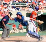 Kansas University catcher Dylan Parzyk scrambles after a wild pitch by pitcher Don Czyz as Clemson batter Doug Hogan, right, waves in Ben Hall from third base with what proved to be the winning run. The No. 2-ranked Tigers beat the No. 25 Jayhawks, 4-3, Sunday in Clemson, S.C.