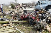 Family members of tornado victims search for personal items Sunday in the area where several houses and mobile homes were destroyed by a tornado near St. Mary, Mo.
