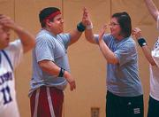 Brady Tanner, left, and Becky Saathoff high-five after a basket during a basketball game Friday night at the East Lawrence Center. Both will be competing in the first-ever Special Olympics USA National Games in Ames, Iowa, in July. Tanner will be competing in power lifting, and Saathoff will compete in swimming.