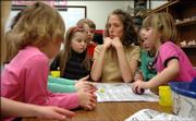 Marisa Hegeman, Lawrence school district art teacher, instructs a kindergarten class at Woodlawn School on how they are going to work with clay to make spheres. Hegeman would like to see funding increase for art in the district, but the school district is uncertain how to budget for the future when state funding amounts are also uncertain.