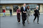 From left Senator Marci Francisco, Rep. Paul Davis and Barbara Ballard and Gov. Kathleen Sebelius leave the Lawrence Airport after an earlier fly over of Lawrence and a press conference at the airport. The Gov. toured the damaged areas of the community Monday morning.