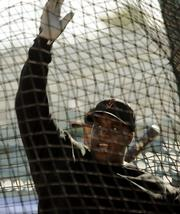 San Francisco's Barry Bonds takes batting practice. Bonds worked Tuesday in Scottsdale, Ariz.