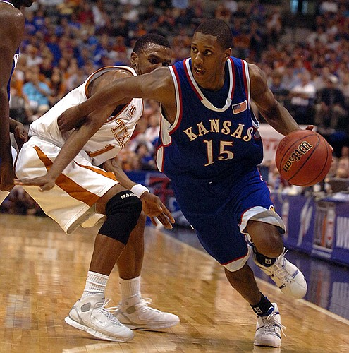 Kansas guard Mario Chalmers leaves Texas defender Daniel Gibson in the dust as he heads for the baseline in the second half.