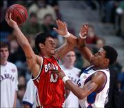 Kansas guard Brandon Rush pressures Bradley guard J.J. Tauai in the first half.