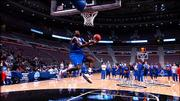 The Jayhawks watch as freshman guard Julian Wright goes up for a windmill dunk toward the end of the 'Hawks' practice Thursday at the Palace of Auburn Hills.