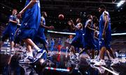The Jayhawks run through a weave during the beginning of practice Thursday afternoon at the Palace in Auburn Hills.