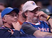 A couple of frustrated Jayhawk fans show their displeasure late in the second half.
