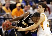 Wichita State's P.J. Couisnard, left, plays keep-away from Tennessee's Dane Bradshaw in the Shockers' 80-73 victory. 