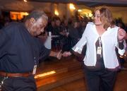 Odell Reed, of the group King Midas and the Muflers, Hutchinson, and Tina Odell, Tulsa, Okla., dance to the music of Fundada during the Kansas Music Hall of Fame ceremony. The Saturday night event honoring musical groups from across the state was at Liberty Hall, 642 Mass.