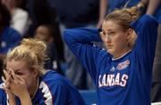 Kansas University Freshmen Jen Orgas, left, and Katie Smith watch from the bench as the final seconds tick off on the Jayhawks' 78-76 loss to Mississippi. KU lost its first-round WNIT game Sunday in Allen Fieldhouse.