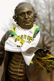 The statue of George Mason on the campus of George Mason University sports a basketball jersey and yellow pom-pom. The statue was decorated Monday in Fairfax, Va., in honor of the school's berth in the round of 16 of the men's NCAA Tournament.