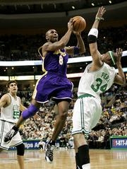 The Lakers' Kobe Bryant drives to the basket on the Boston Celtics' Paul Pierce, right. Bryant scored 43 points as the Lakers cruised past the Celtics, 105-97, Monday in Boston.