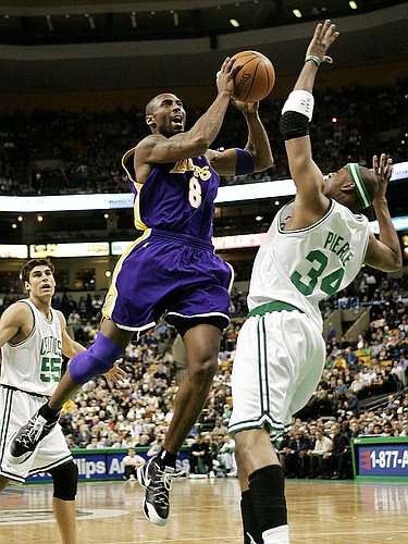 The Lakers' Kobe Bryant drives to the basket on the Boston Celtics' Paul Pierce, right. Bryant scored 43 points as the Lakers cruised past the Celtics in Boston.