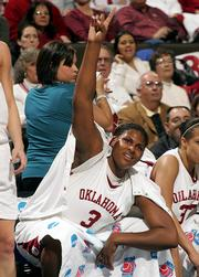 Oklahoma center Courtney Paris celebrates a basket in the final minutes of OU's 86-70 victory over BYU. The Sooners won their second-round NCAA Tournament game Monday in Denver.