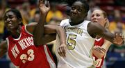 New Mexico's Dionne Marsh, left, and teammate Julie Briody try to block out Baylor's Abiola Wabara in the second half. Baylor won, 87-67, in the second round of the NCAA Tournament on Monday in Tucson, Ariz.