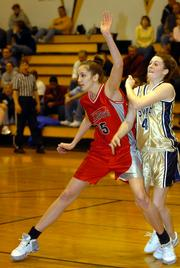 Ashli Hill, left, works to get open during an AAU tournament at South Junior High. At 6-foot-4, the eighth grader usually has a tremendous size advantage over opponents.