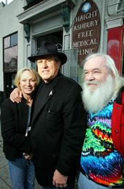 "Dr. David Smith, center, stands outside the Haight Ashbury Free Medical Clinic with his wife, Millicent Buxton-Smith, and former IT manager Bob Student in San Francisco. ""Dr. Dave"" opened the clinic in 1967 but quit last month when a new CEO made changes to increase the clinic&squot;s financial accountability."