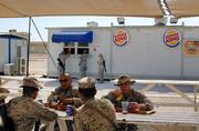 U.S. soldiers eat meals from Burger King, in al-Asad Air Base, 100 miles west of Baghdad, Iraq. As the construction work goes on in full scale at the Balad U.S. Air Base and handful of other installations, it is difficult to say whether U.S. forces in Iraq are in for a short term or long term stay.