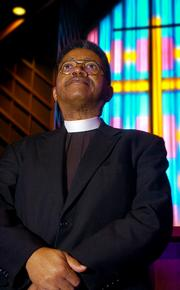 The Rev. Joseph Rembert stands at the altar where Rosa Parks' body lay during a memorial service last fall at St. Paul A.M.E. church in Montgomery, Ala. Lampert has spoken out against a bill that would pardon Rosa Parks and others who  were arrested during the Civil Rights Movement.