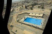 The Balad air base boasts an Olympic-size swimming pool, seen from a Black Hawk helicopter, among its amenities. Balad, the former Iraqi air force academy, has become the logistics hub for all U.S. military operations in Iraq.