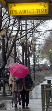 Thanks to chilly rain and brisk winds, it didn't feel like the first day of spring Monday in Lawrence, where these downtown pedestrians sheltered themselves with an umbrella. Nearly an inch of rain fell in Lawrence, bringing much-needed precipitation to the area.
