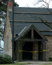 A temporary tar-paper roof protects Danforth Chapel until a permanent replacement can be built. The new roof likely won't be finished until early July, according to Kansas University construction officials.