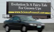 Lawrence resident Dave Penny, who served on the transition team that, late last year, advised newly appointed Education Commissioner Bob Corkins, helped put up this billboard poking fun at evolution. The sign is on Interstate 35 near 151st Street in Olathe.