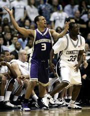 Washington's Brandon Roy (3) reacts in disgust as Connecticut's Denham Brown defends during their Sweet 16 game. UConn won, 98-92 in overtime, Friday in Washington.