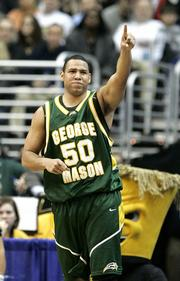George Mason's Sammy Hernandez celebrates in the second half against Wichita State. The Patriots beat the Shockers, 63-55, Friday in Washington to advance to the Elite Eight.
