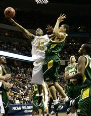 Wichita State's Karon Bradley (10) shoots over George Mason's Tony Skinn. The Patriots beat the Shockers, 63-55, Friday night in Washington.