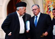 Iraqi President Jalal Talabani, right, speaks with Sunni Arab leader Adnan al-Dulaimi on Friday after a meeting of Iraqi political leaders in Baghdad, Iraq.