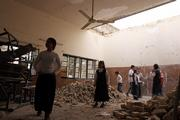 Students of Dijla primary school in Baghdad, Iraq, play in a damaged classroom. A mortar shell slammed into the school in February, killing one student and injuring 10.