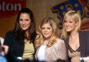 "The Dixie Chicks, from left, Emily Robison, Natalie Maines and Martie Maguire pose during a 2003 news conference in New York. The trio was banned from many country stations in 2003 after Maines criticized President Bush on a London stage. But their new single, ""Not Ready to Make Nice,"" is in rotation in several markets."