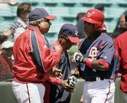 Washington's Alfonso Soriano, right, celebrates his leadoff home run with Nationals manager Frank Robinson. Soriano struggled in the outfield, but stood out at the plate in the Nationals' 13-6 victory Sunday in Viera, Fla.