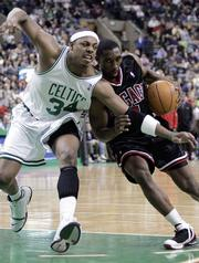 Chicago's Ben Gordon, right drives against Boston's Paul Pierce during the fourth quarter. The Bulls beat the Celtics, 101-97, Sunday at Chicago's United Center.