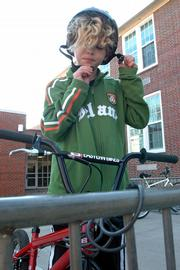 More children in Lawrence would receive free bike helmets if Lawrence-Douglas County Fire & Medical receives a grant it has applied for. Liam Reynolds 10, a fifth-grader at Woodlawn School, recently donned his helmet before riding home.