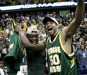 George Mason's Sammy Hernandez (50) and Tony Skinn celebrate their overtime victory over Connecticut. The Patriots won, 86-84 in overtime, Sunday in Washington to advance to the Final Four.