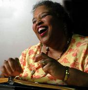 Lynda Anders Canaday laughs after she and her accompanist went in different directions during a rehearsal. Canaday was following the lyrics on a Braille version in her notebook. After recovering from severe depression a year ago, Canaday has returned to school and is majoring in vocal performance at Kansas University.