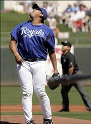 Kansas City Royals starting pitcher Runelvys Hernandez lets out a yell as he watches Kansas City Royals Michael Barret's three- run homer fly in the second inning during spring training exhibition baseball in Surprise, Ariz., Saturday, March 25, 2006.