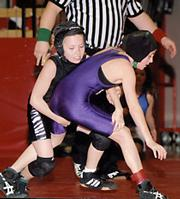 Payton Covert, left, works for a takedown on Feb. 26 at teh U.S. Girls Wrestling Association Kansas State Tournament. Covert won the title in her 12-and-under division weight class.