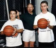 Bob Drake instructs two students on the proper eye contact and body position to the basket. Drake has built his Excellence in Basketball program around teaching kids proper shooting techinique.