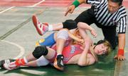 Reece Conklin wrestles against B.T. O'Hara in the finals of the 12-and-under 100-pound divison. Conklin held the Columbus Wrestling Club's O'Hara scoreless, 5-0, to become Sunflower Kids Wrestling Club's first three-time state champion.