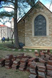 Danforth Chapel, the popular wedding site on Kansas University's campus, won't reopen until at least Aug. 1. Tiles from the historic structure's roof were removed after the March 12 storm.